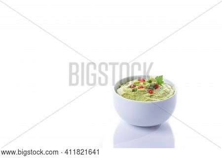 Guacamole Bowl Isolated On White Background With Copy Space.