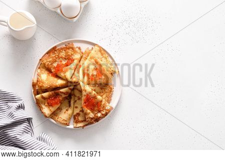 Russian Blini With Red Caviar On White. Top View. Shrovetide.