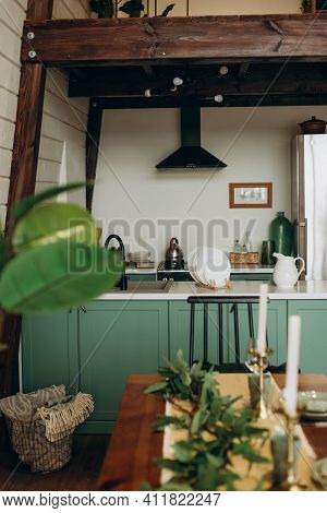 Stylish Cozy Green Kitchen In A Loft Style. Modern Interior. Soft Selective Focus.