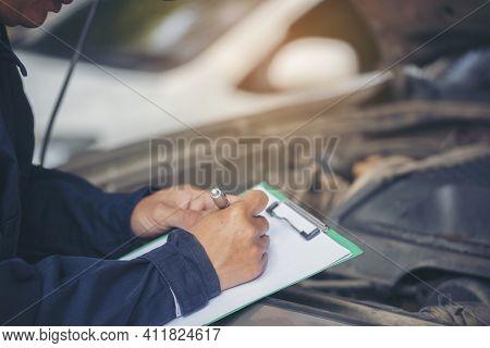 Mechanic Car Service Auto Garage In Automotive Mobile Center. Technician Workshop Repair Engine Moto