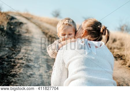 Mothers Day, Celebrates Motherhood, Holiday In Honor Of Mothers. Little Boy Kid Son Runing Into The