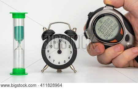 Different Time Counters. Selective Focus. Hourglass, Alarm Clock, And Digital Stopwatch. Time Measur