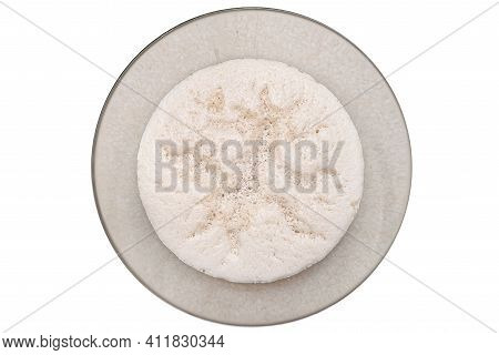 Raw, Ripening Yeast In A Glass Dish, Isolated On A White Background, Top View.