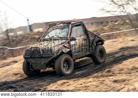 Dirty 4x4 Vehicle Starting In A Off Road Competition. Dynamic Shot Of  Car On  In The  Off  Road Cir