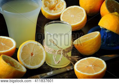 Fresh Lemon Juice And Lemons. The Process Of Extracting Lemon Juice.