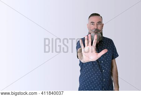 Bearded Hipster 40-45 Years Old, Reaching Out And Putting His Hand In Front Of Him As A Sign Of Stop