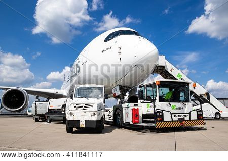 Berlin, Germany - Apr 27, 2018: New Modern Airbus A350 Xwb Passenger Jet Plane About To Be Towed By