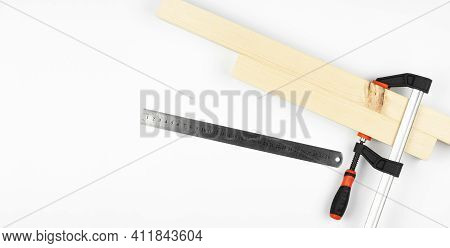 Iron Clamps. Tool. Clamps And Vices. On A White Background. Wooden Bars