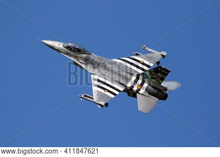 Belgian Air Force F-16 Fighter Jet Special Painted With D-day Invasion Stripes In Flight Over Kleine
