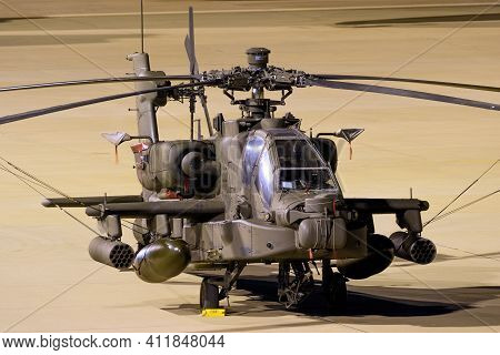 Us Army Boeing Ah-64e Apache Guardian Attack Helicopter On The Tarmac During A Nightstop At Eindhove