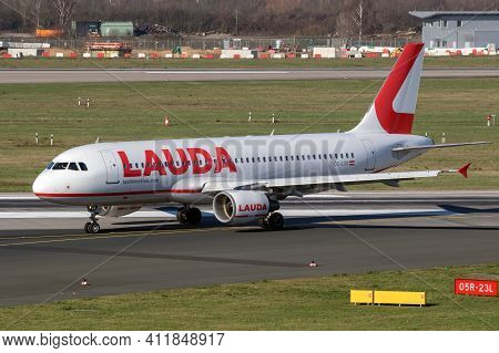 Lauda Airline Airbus A320 Passenger Plane Taxiing At Dusseldorf Airport. Germany - February 7, 2020