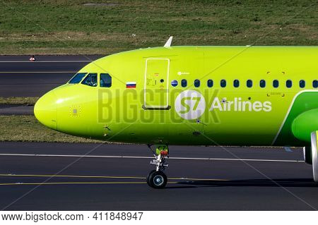 S7 Airlines Airbus A320 Passenger Plane Taxiing After Landing At Dusseldorf Airport. Germany - Febru