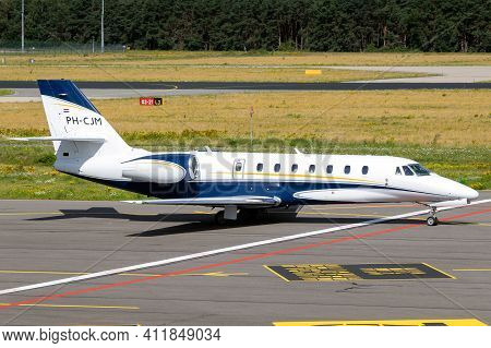 Cessna 680 Citation Sovereign Corporate Business Jet Taxiing On The Tarmac Of Eindhoven Airport. The