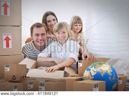 Composition of cardboard boxes with globe, happy family unpacking in new home. moving house, global shipment and delivery concept digitally generated image.