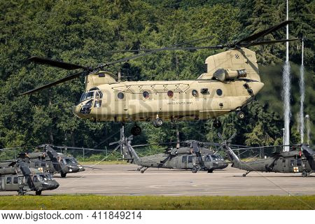 Us Army Boeing Ch-47f Chinook Transport Helicopter Taking Off With Uh-60 Blackhawk Helicopters In Th