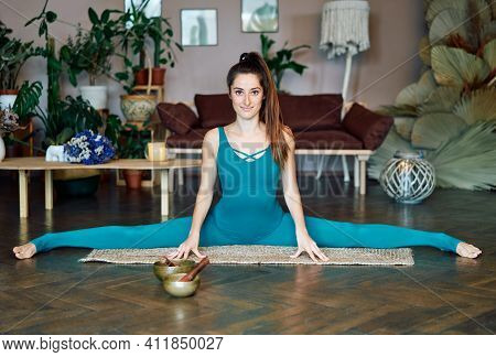 Young Sporty Woman Practicing Yoga At Home Doing Stretching Exercise The Center Split Pose, Straight