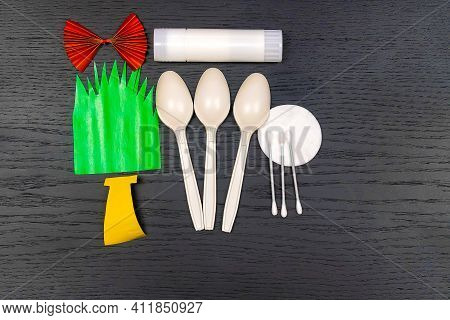 How To Make Easter Bunnies From Biodegradable Spoons And Colored Paper. Doing Paper Crafts. Concept