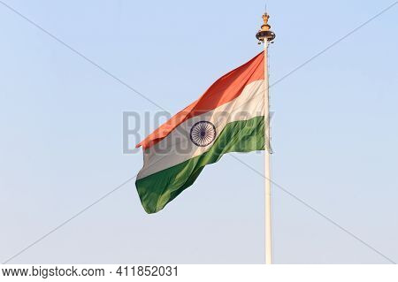 Indian Flag Flying Against Blue Sky Background. The National Flag Of India Is A Horizontal Rectangul