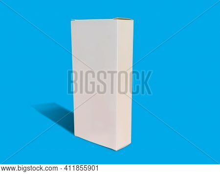 White Folding Cartons Isolated On Blue Color Background.  Straight Tuck End. Paperboard Boxes Front