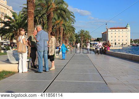 Split, Croatia - September 16, 2012: People Visit The Embankment Of Split, Croatia. Split's Historic
