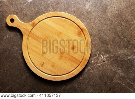 Pizza or bread cutting board for homemade baking on table. Food recipe concept at stone background texture with copy space. Flat lay top view