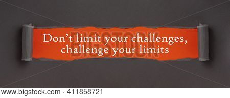Don't Limit Your Challenges, Challenge Your Limits - Appearing Behind Torn Brown Paper. Motivation E