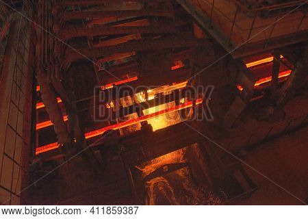 Steel Production In Electric Furnaces. Sparks Of Molten Steel. Electric Arc Furnace Shop . Metallurg
