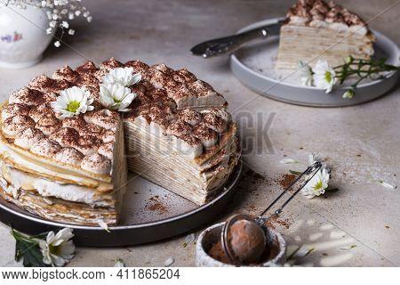Tiramisu Crepe Cake With Mascarpone And Amaretto On A Light Background
