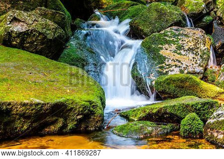 Waterfall Of Jedlova. Small Waterfall With Mossy Granite Rocks. Jizera Mountains, Northern Bohemia,