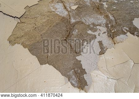 Old Peeling Paint On A Cracked Or Frayed Concrete Wall. Overhaul Of The Premises.