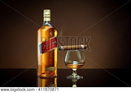 Phuket, Thailand- Feb 2021. Johnnie Walker Red Label Blended Whisky Isolated On Color  Background. J