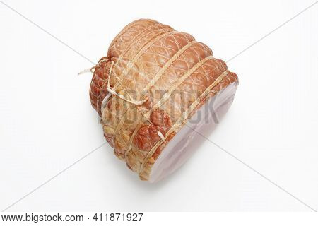 Top View Of Smoked Ham Isolated On A White Background. Homemade, Smoked Cold Cuts, In Netting, Cut,