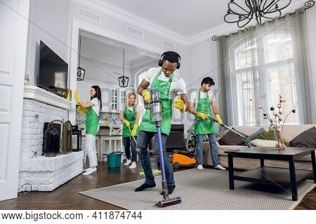 Handsome Young African Worker Of Cleaning Service, Cleaning Up Carpet And Dancing, Listening To Musi