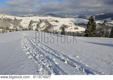 Scene with trail on winter mountain slope, Carpathians in Ukraine