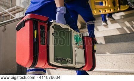 Selective Focus Automated External Defibrillator (aed) On Hand Of Paramedic. Emergency Team Service.