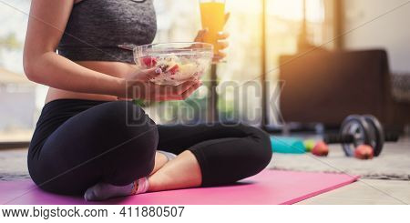 Fitness Sport Woman In Fashion Sportswear Eating Healthy Salad Fruit Bowl. Healthy Eating, Dieting A