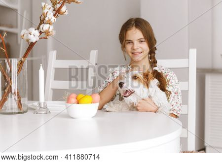 1 White Teenage Girl 10 Years Old Sits At The Kitchen Table And Hugs Dog Jack Russell Dog, Easter  E