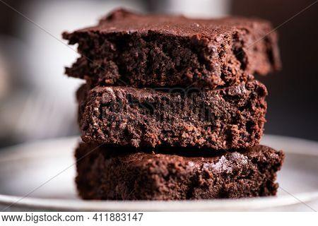 Dark Chocolate Brownies. Three Delicious Square Pieces Of Fudgy Chocolate Brownies On A Plate, Close