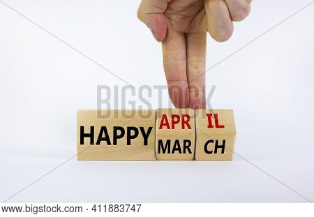 Symbol For The Change From March To April. Businessman Turns Wooden Cubes And Changes Words 'happy M