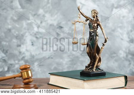 Justice Lady On Book With Judge On Table