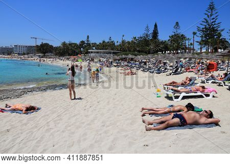 Nissi Beach, Cyprus - May 16, 2014: People Relax At Nissi Beach In Cyprus. Tourism Makes About 10 Pe