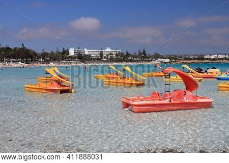 Nissi Beach, Cyprus - May 16, 2014: Paddleboats With Slides At Nissi Beach In Cyprus. Tourism Makes