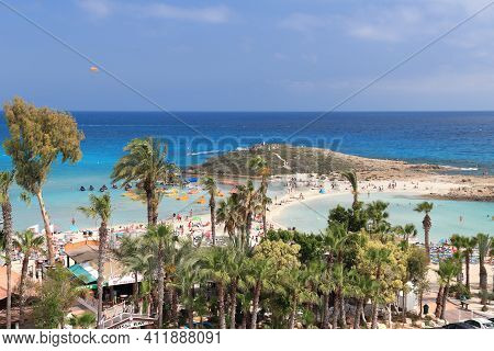 Nissi Beach, Cyprus - May 16, 2014: People Visit Nissi Beach In Cyprus. Tourism Makes About 10 Perce