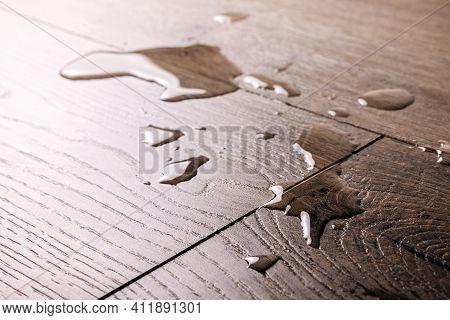 Waterproof Flooring - Spilled Water Drops On Wooden Laminate Floor