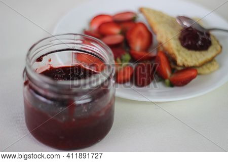 Half Full Bottle With Home Made Strawberry Jam Shot Along With Home Baked Plain Mildly Sweet Butterm