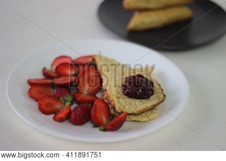 Home Baked Plain Mildly Sweet Buttermilk Scones Served Along With Homemade Strawberry Jam And Fresh