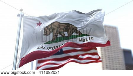 The California Republic Flag With The Grizzly Bear Monarch Flying Along With The American National S
