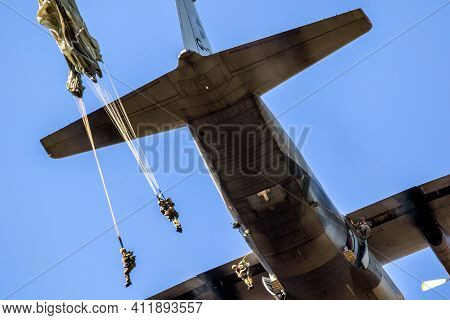 Ede, Netherlands - Sep 21, 2019: Military Paratroopers Parachute Jumping Out Of A Air Force C-130 He