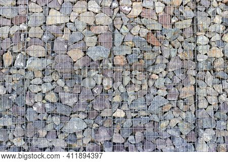 Background Of Gabion Wall From Steel Mesh And Large Stones