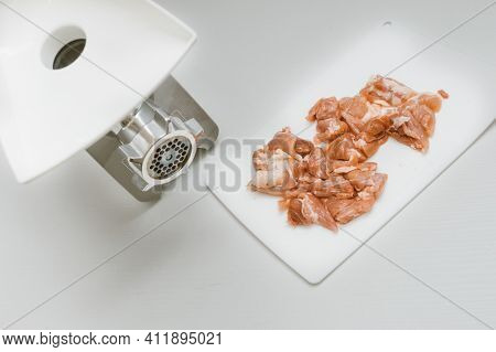 On The Kitchen Table, Chicken Meat And A Meat Grinder. Minced Meat